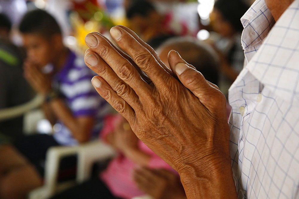 Hands in prayer, Khao Pansa celebration at Wat Ampharam, Hua Hin, Thailand, Southeast Asia, Asia