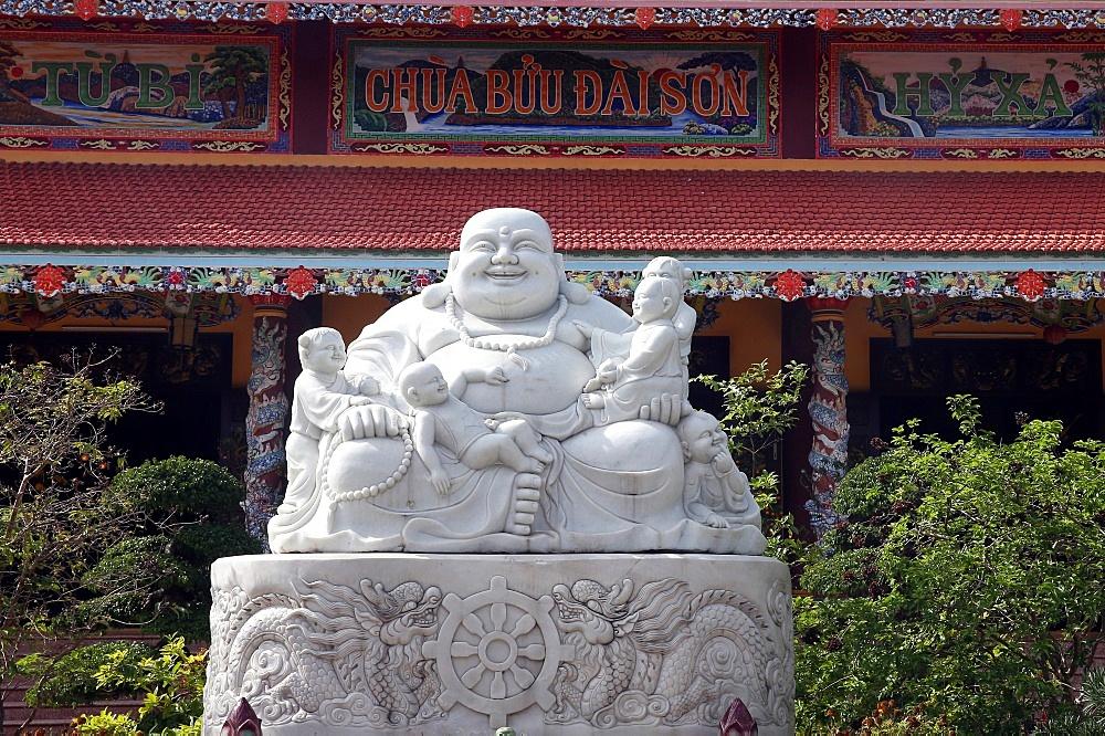 Chua Buu Dai Son buddhist pagoda. Smiling Buddha - Chinese God of Happiness, Wealth and Lucky. Statue. Danang. Vietnam.