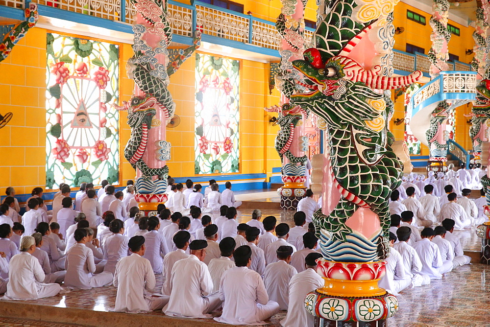 Praying devout men and women, ceremonial midday prayer, Cao Dai Holy See Temple, Tay Ninh, Vietnam, Indochina, Southeast Asia, Asia
