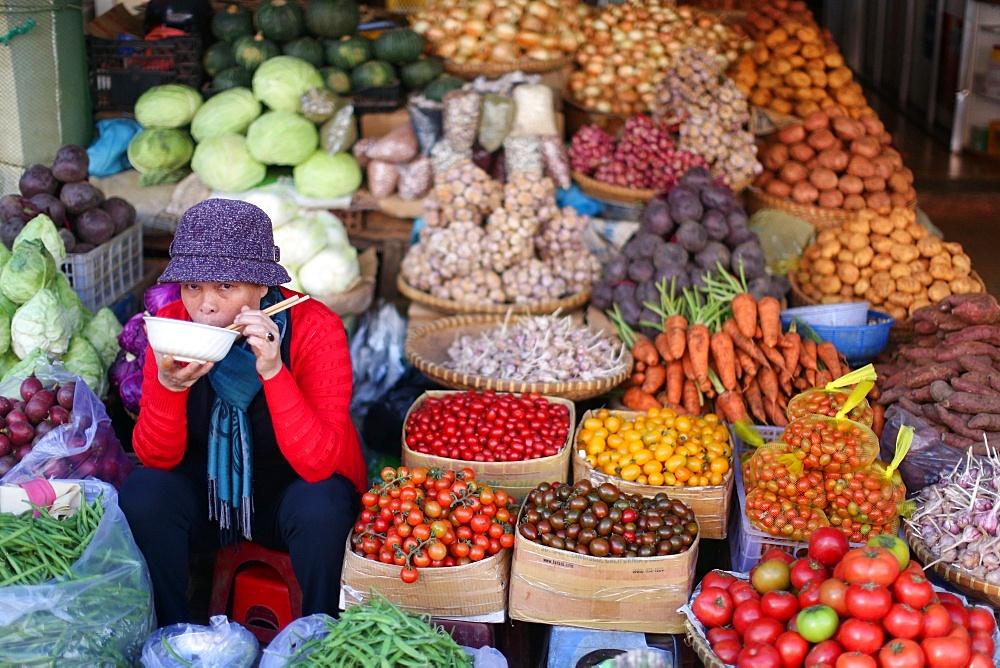 Woman selling fresh vegetables on market. Dalat. Vietnam.