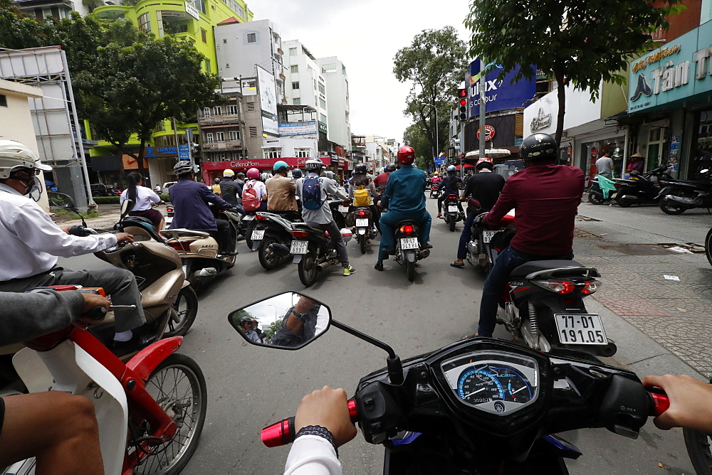 Vietnamese People on Motorbikes. Road traffic. Ho Chi Minh City. Vietnam.