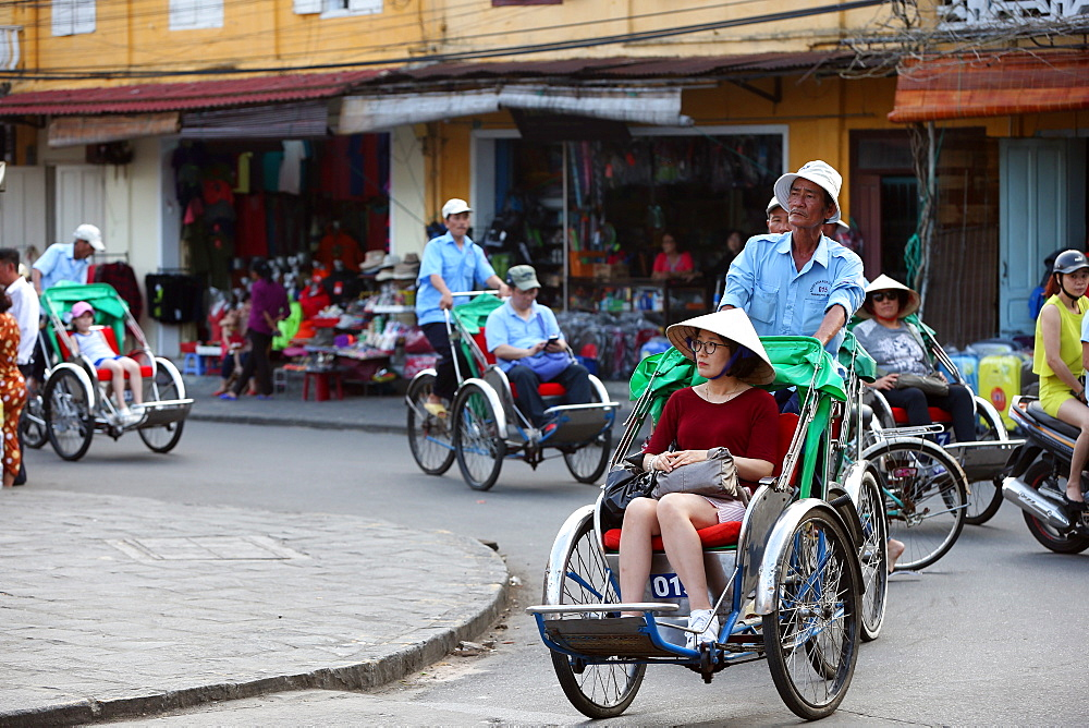 Transportation by cyclo, Vietnamese pedicab. Hoi An. Vietnam.