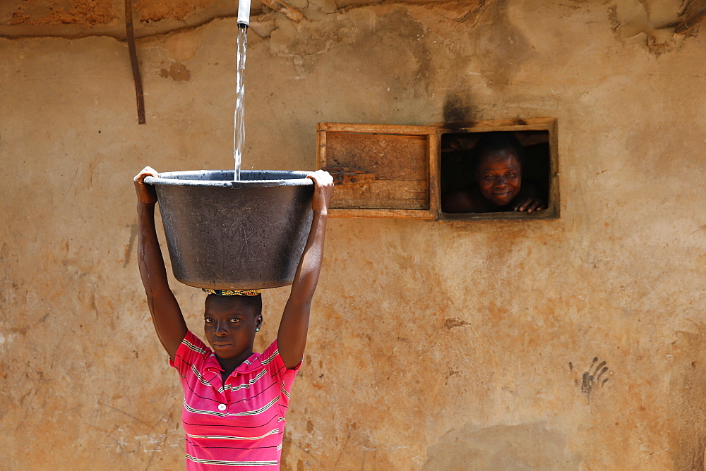 Collecting water in a Zou province village, Benin.