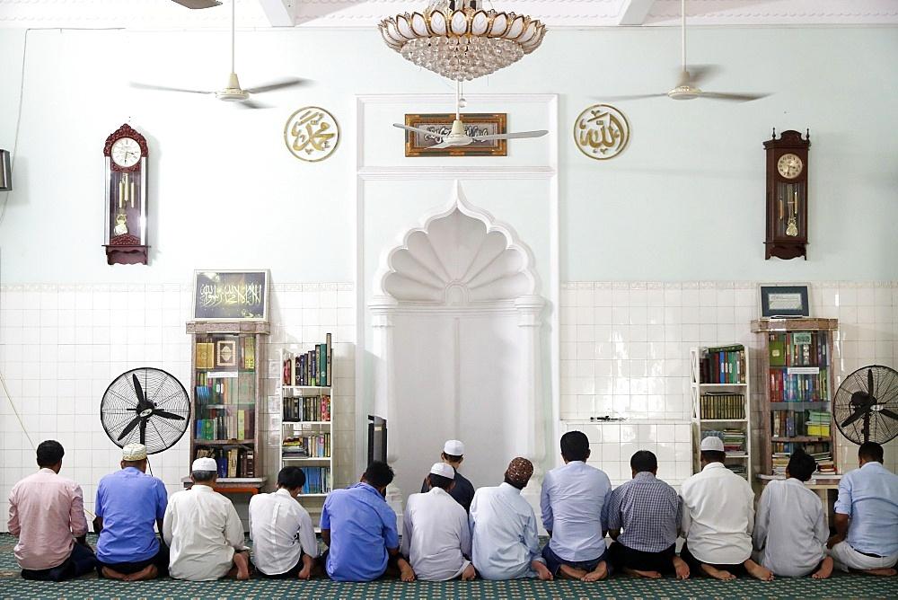 Saigon Central Mosque. Muslim men praying. Ho Chi Minh City. Vietnam.