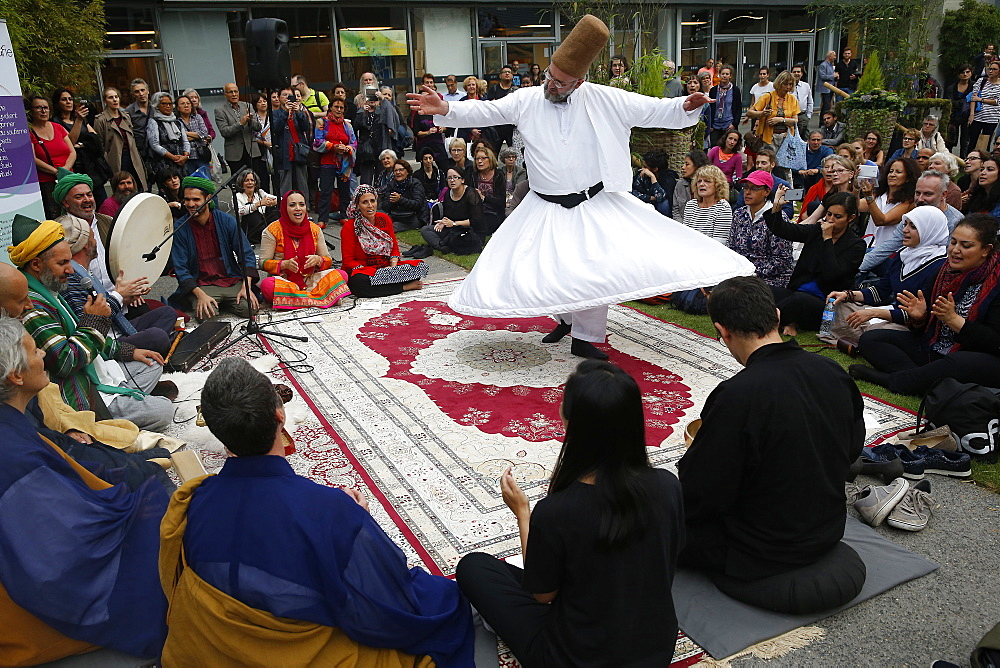 Whirling Dervish at gathering of Zen Buddhists and Muslim Sufis praying and celebrating together at the Salon Zen, Paris, France, Europe