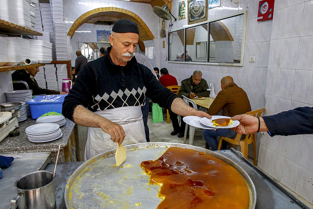 The most famous knaffieh (Palestinian cheese pastry) shop in Nablus, West Bank, Palestine, Middle East - 809-7624