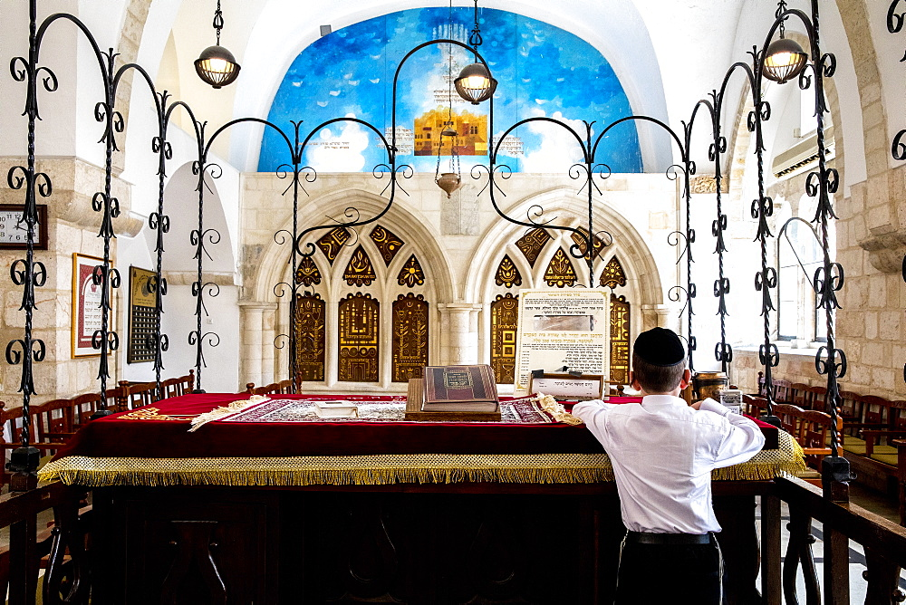 Boy reading at the teva, the four Sephardic Synagogues, Jerusalem old city, Israel, Middle East - 809-7655