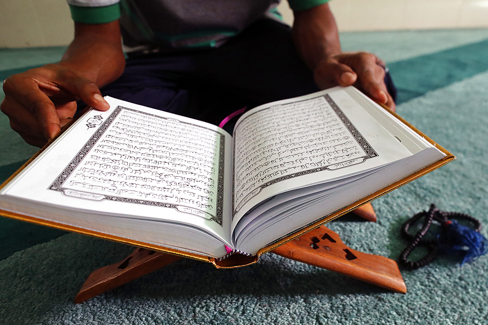 Muslim reading the Quran in mosque. Ho Chi Minh city. Vietnam.