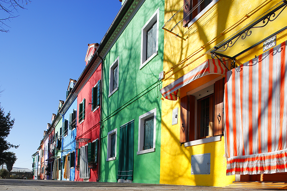 Multi colored houses in Burano village. Italy.