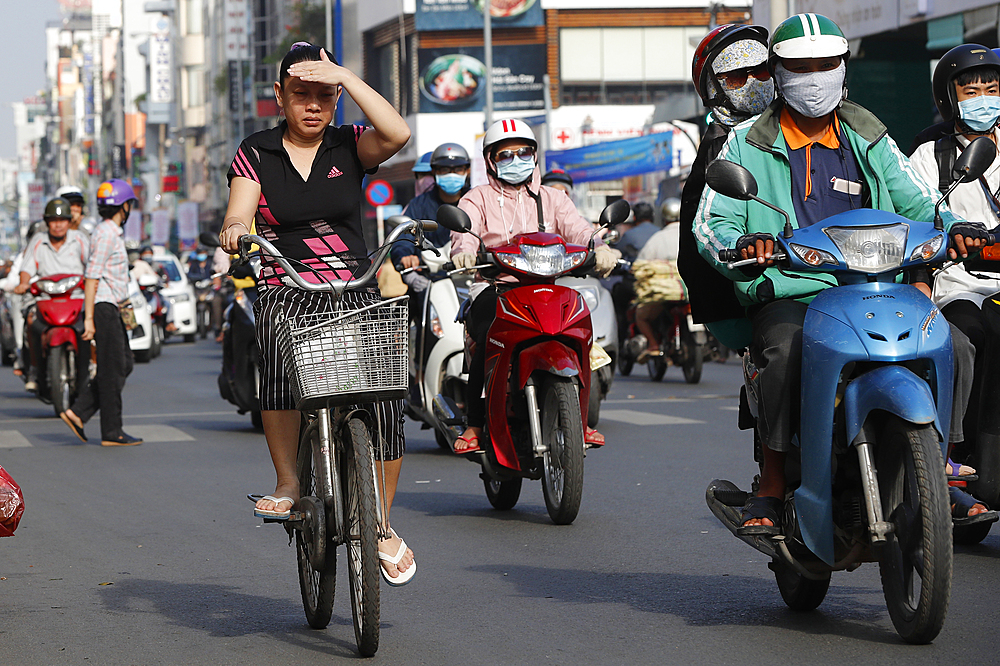 Bicycle and motorbikes on traffic road. Ho Chi Minh city. Vietnam.