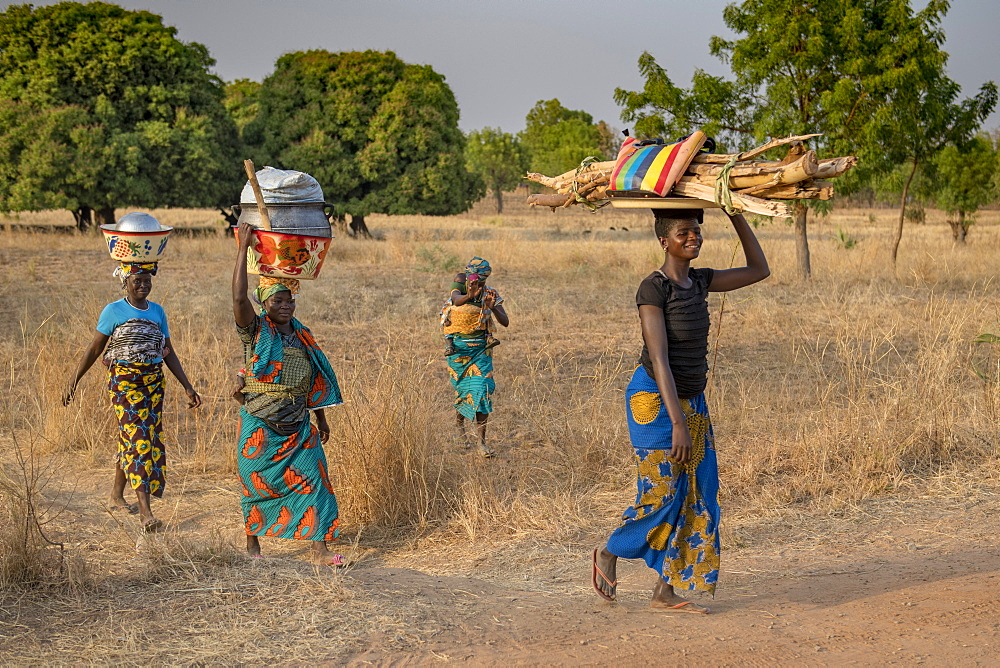 Togolese women walking in Savanes province, Togo, West Africa, Africa