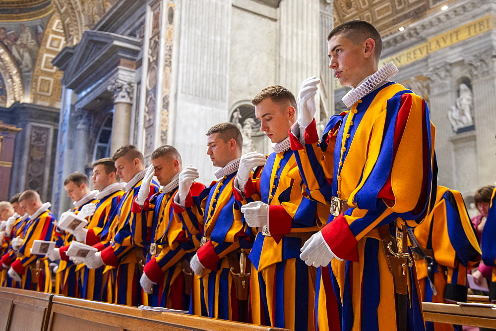 Holy Mass at the altar of the Chair of St. Peter's Basilica for the 23 new guards who will take the solemn oath. Vatican city.