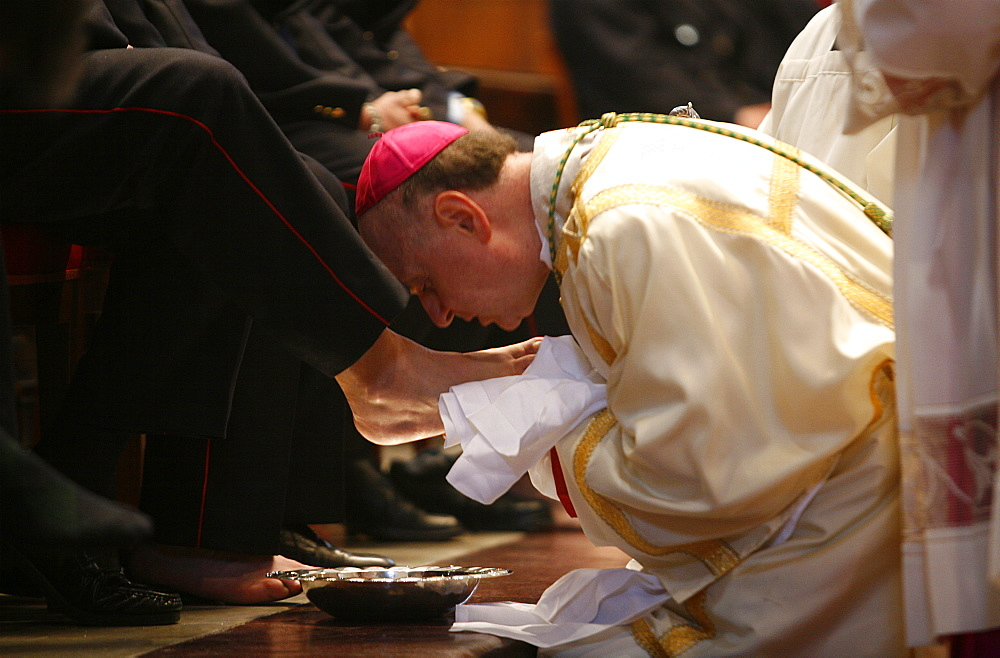Bishop kissing feet after washing them, Easter Thursday Mass in St. Peter's Basilica, Vatican, Rome, Lazio, Italy, Europe - 809-791