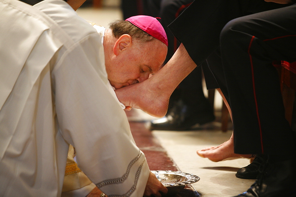 Bishop kissing feet after washing them, Easter Thursday Mass in St. Peter's Basilica, Vatican, Rome, Lazio, Italy, Europe - 809-792