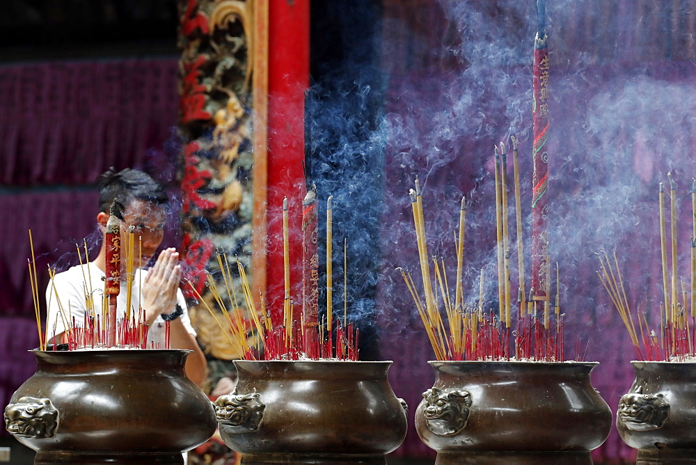 Taoist temple. Phuoc An Hoi Quan Pagoda. Incense sticks on joss stick pot are burning and smoke use for pay respect to Buddha