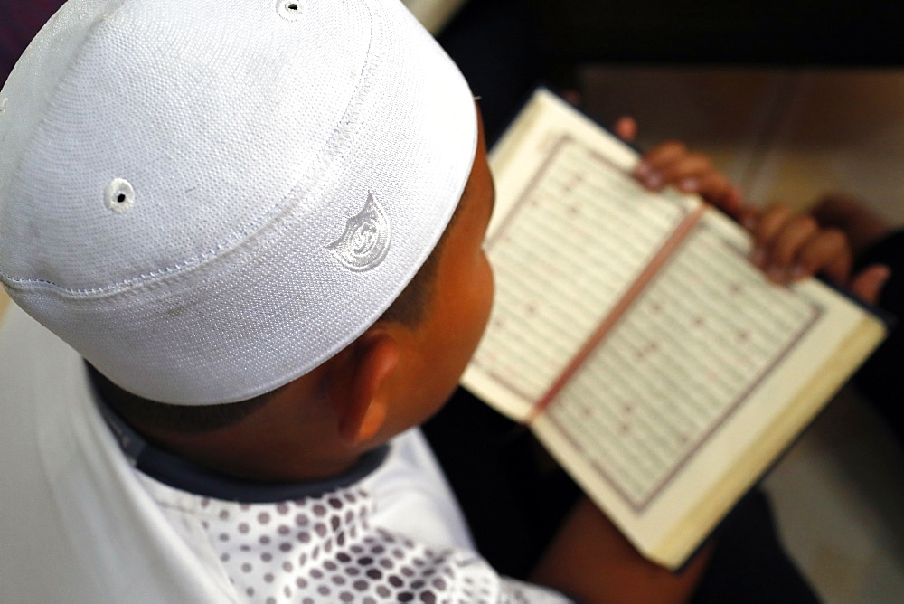 Muslim boy learning Quran at Islamic school, with Kufi hat, Ho Chi Minh City, Vietnam, Indochina, Southeast Asia, Asia