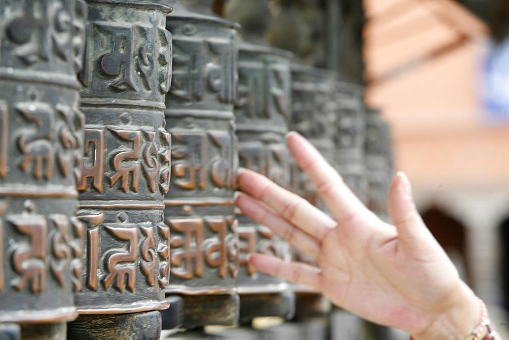 Tibetan prayer wheels, Swayambhunath temple, Kathmandu, Nepal, Asia