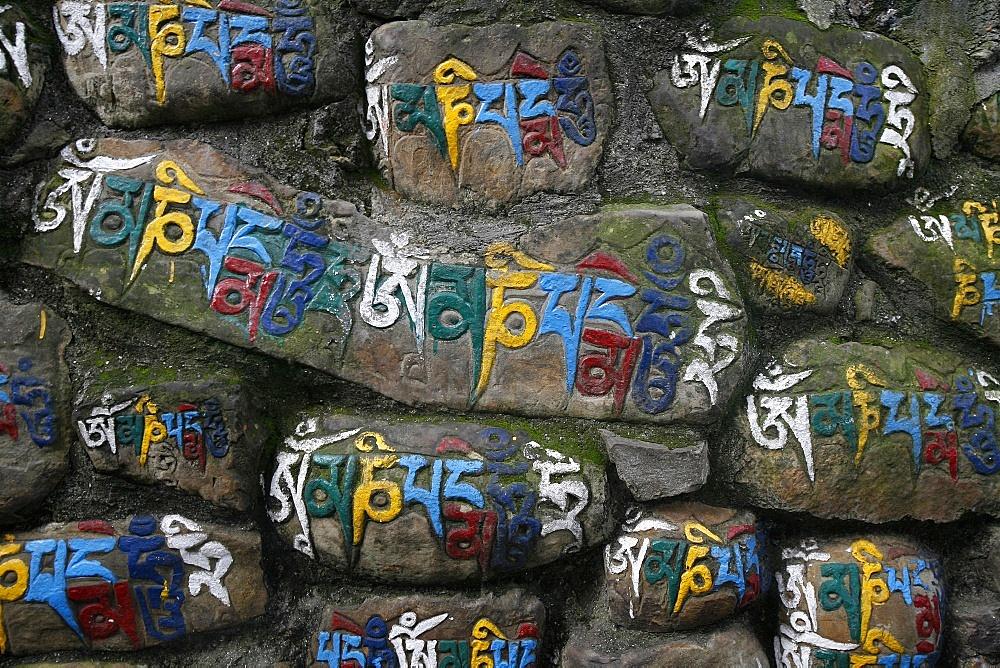 Close-up of Mani stones, Swayambhunath temple, Kathmandu, Nepal, Asia