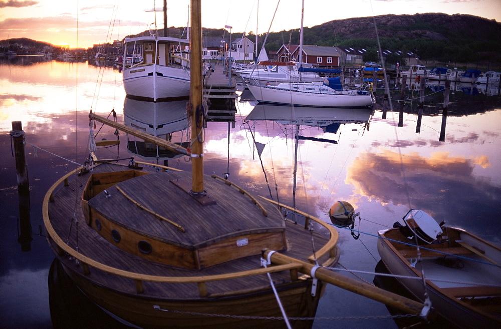 Sundown over South Harbour, Hamburgsund, Bohuslan, Sweden, Scandinavia, Europe