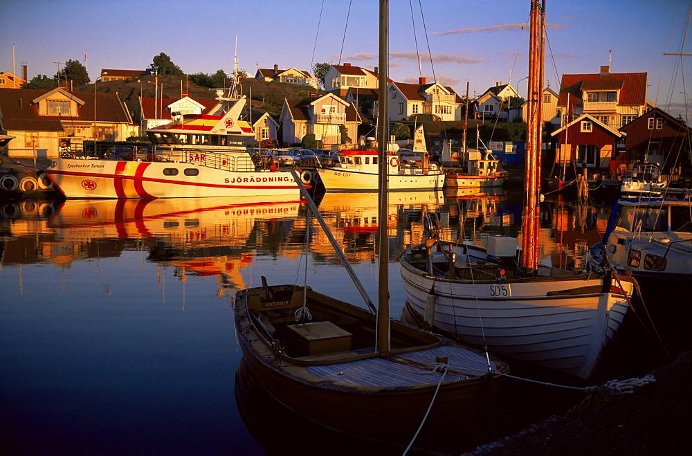 Sundown over South Harbour, village of Fjallbacka, Bohuslan, Sweden, Scandinavia, Europe