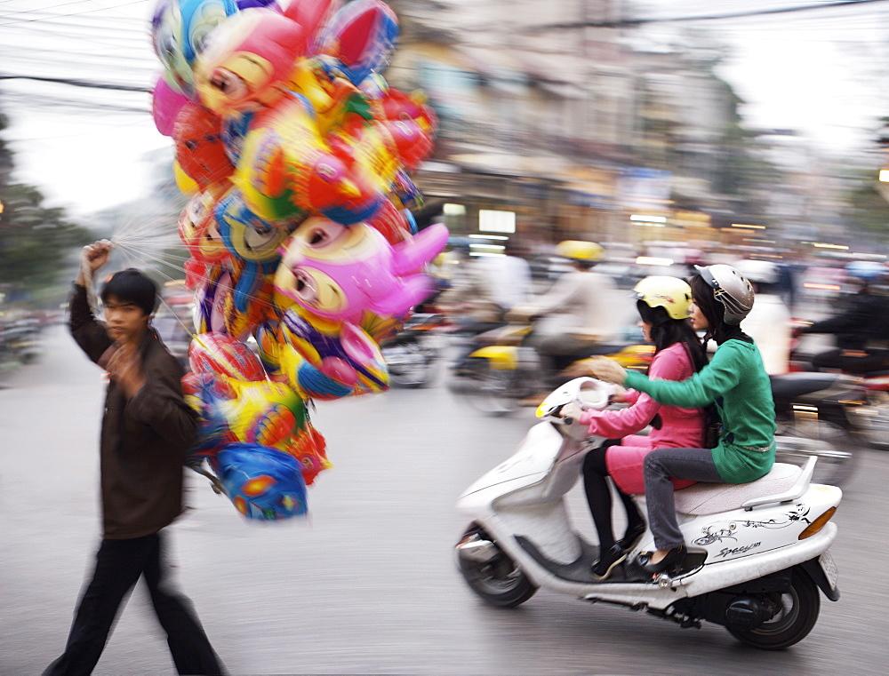 Man selling Balloons, Hanoi, Vietnam, Indochina, Southeast Asia, Asia