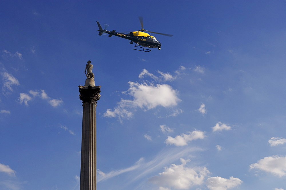 Nelsons Column and police helicopter, London, England, United Kingdom, Europe - 812-120