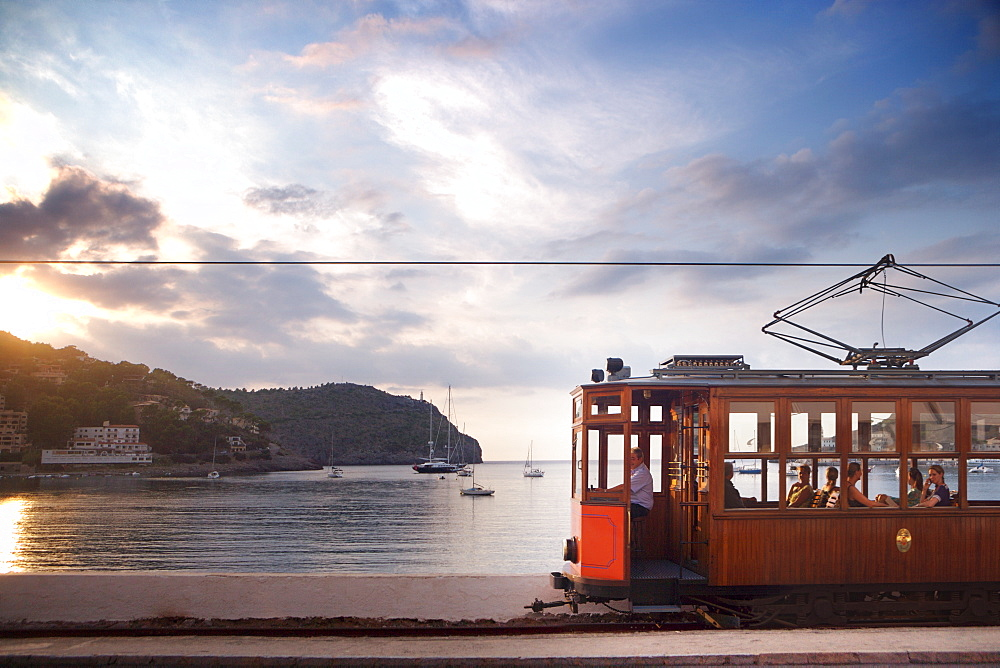 Tram at sunset set against yachts in bay, Soller, Mallorca, Balearic Islands, Spain, Mediterranean, Europe - 812-125