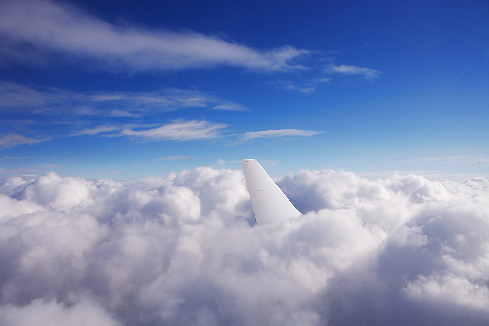 Aircraft tail fin in clouds - 812-139