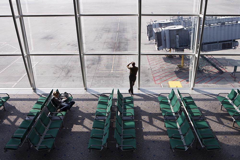 Man wan waiting at airport gate, Chek Lap Kok Airport, Hong Kong, China, Asia