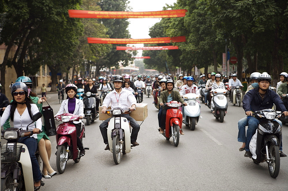 Mopeds coming towards camera, Hanoi, Vietnam, Indochina, Southeast Asia, Asia