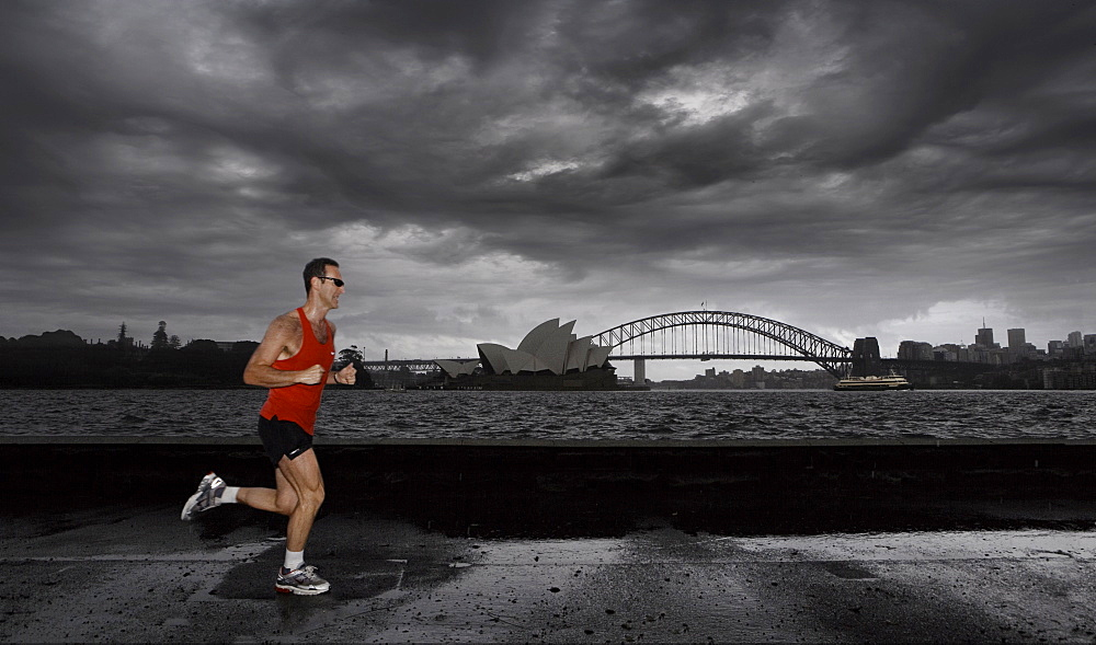 Man jogging in front of Sydney harbour, Sydney, New South Wales, Australia, Pacific - 812-79