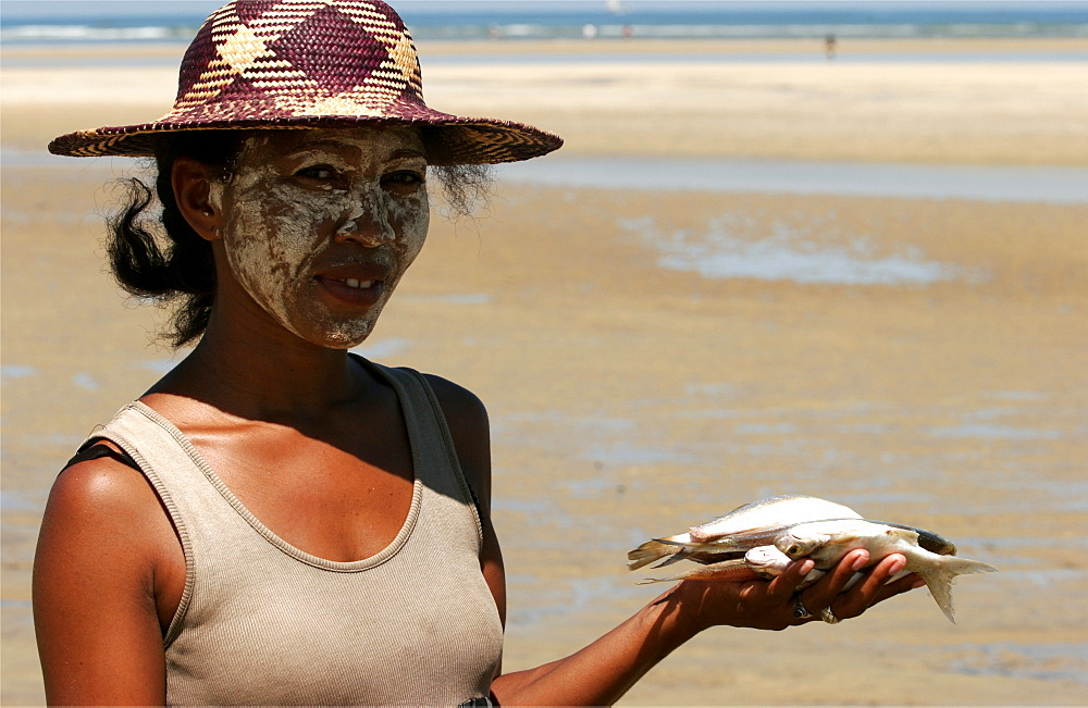 On the beach of Morondava, a Vezo woman has just bought some fish, Madagascar, Africa