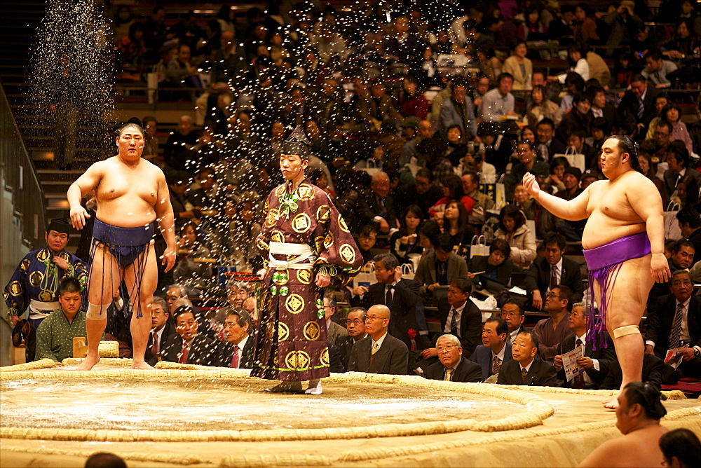 Some sumo fighters throwing salt before a fight at the Kokugikan stadium, Tokyo, Japan, Asia - 814-1523