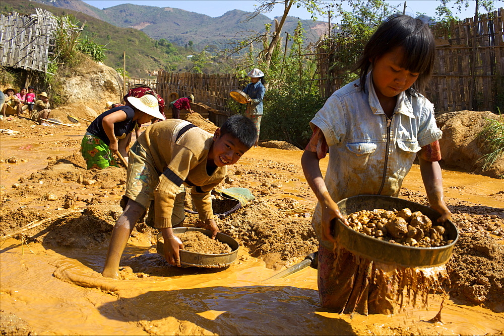 Boys searching for ruby stones in Mogok mining sites, Myanmar (Burma), Asia - 814-1570