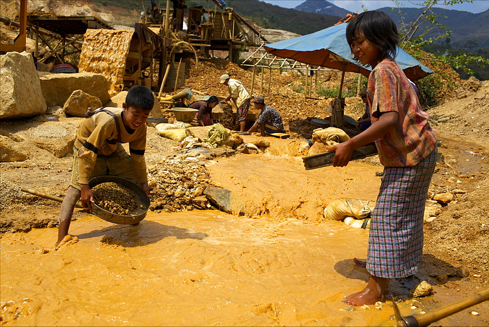 Boys searching for ruby stones in Mogok mining sites, Myanmar (Burma), Asia