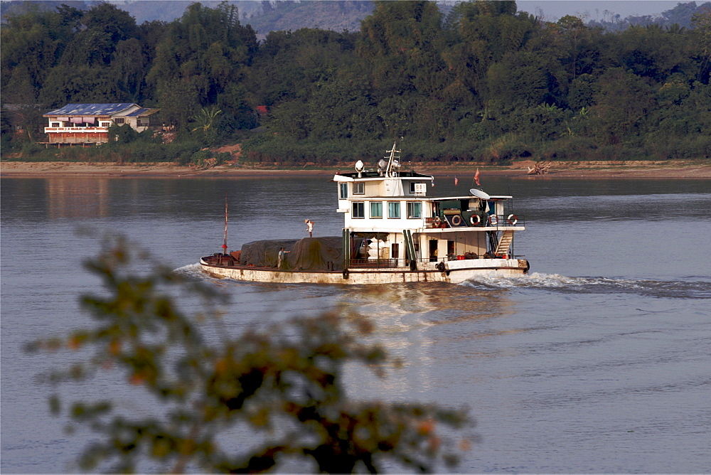 A small cargo boat on the Mekong River, in the northern area around Sop Ruak and the Laos and Burma borders, Thailand, Southeast Asia, Asia