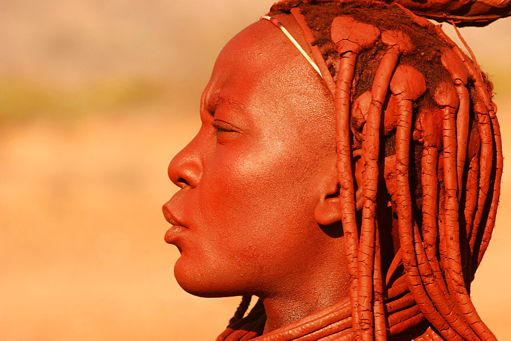 Young Himba woman from the Kunene River, on the border with Angola, Namibia, Africa
