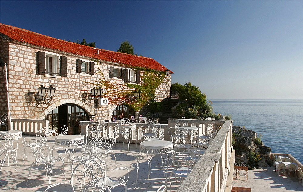 Terrace of the restaurant on the island hotel of Sveti Stefan, Montenegro, Europe