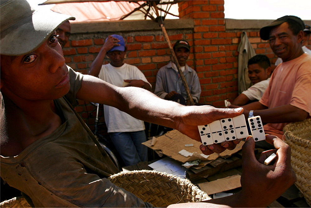 Domino players at the Antsirabe market, Madagascar, Africa