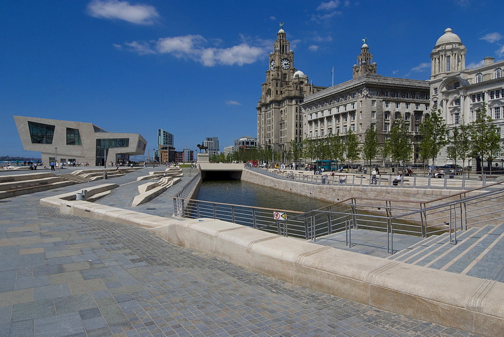 New Liverpool Museum and Leeds Liverpool Canal link in front of the Three Graces (the Liver, Cunard and Port of Liverpool Buildings), Liverpool, Merseyside, England, United Kingdom, Europe