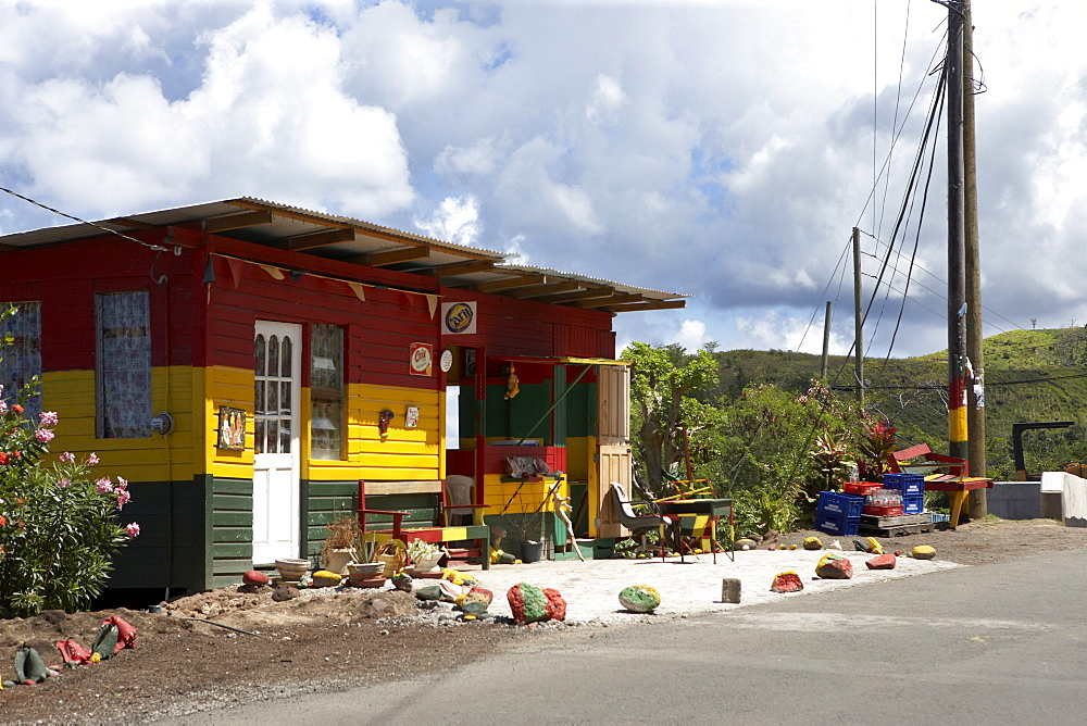 Roadside wooden building painted red, yellow and green, Grenada, Windward Islands, West Indies, Caribbean, Central America