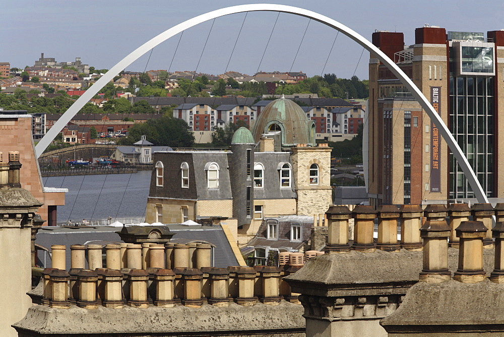 Gateshead Millennium Bridge and BALTIC Centre for Contemporary Art against sky seen over rooftops and chimneys, Newcastle Upon Tyne, Tyneside, England, United Kingdom, Europe - 815-2208