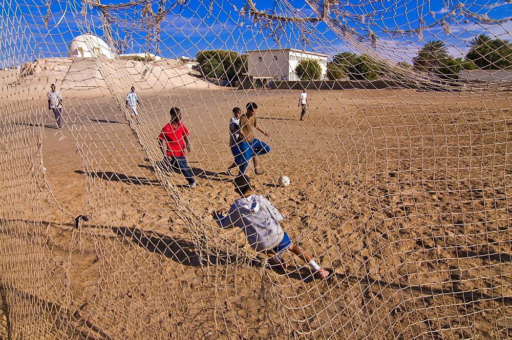 Children playing soccer at a sandy field, Nouadhibou, Mauritania, Africa
