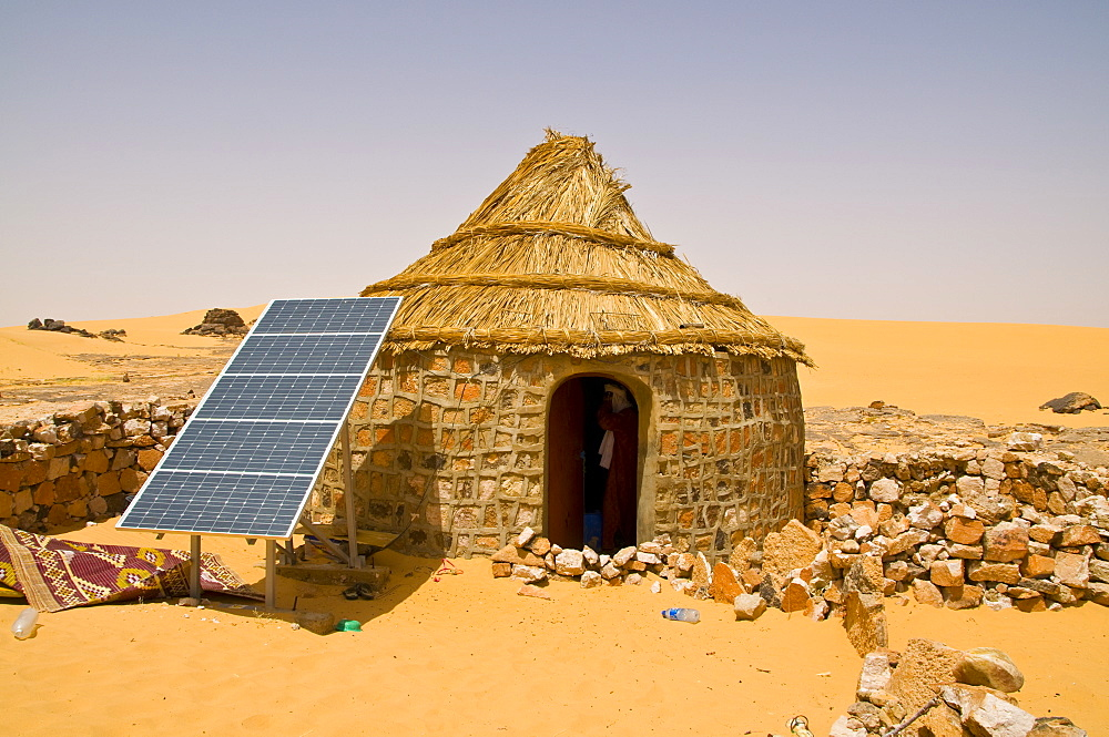 Traditional house with a solar panel in the Sahara Desert, Algeria, North Africa, Africa