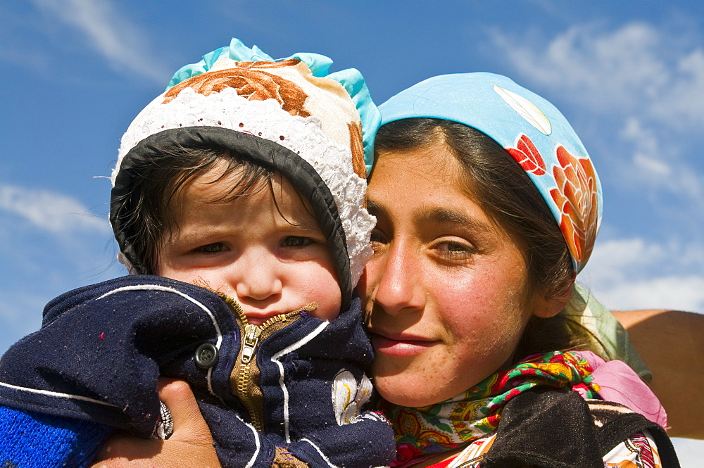 Young Pamir girl holding her little brother, Tajikistan, Central Asia, Asia