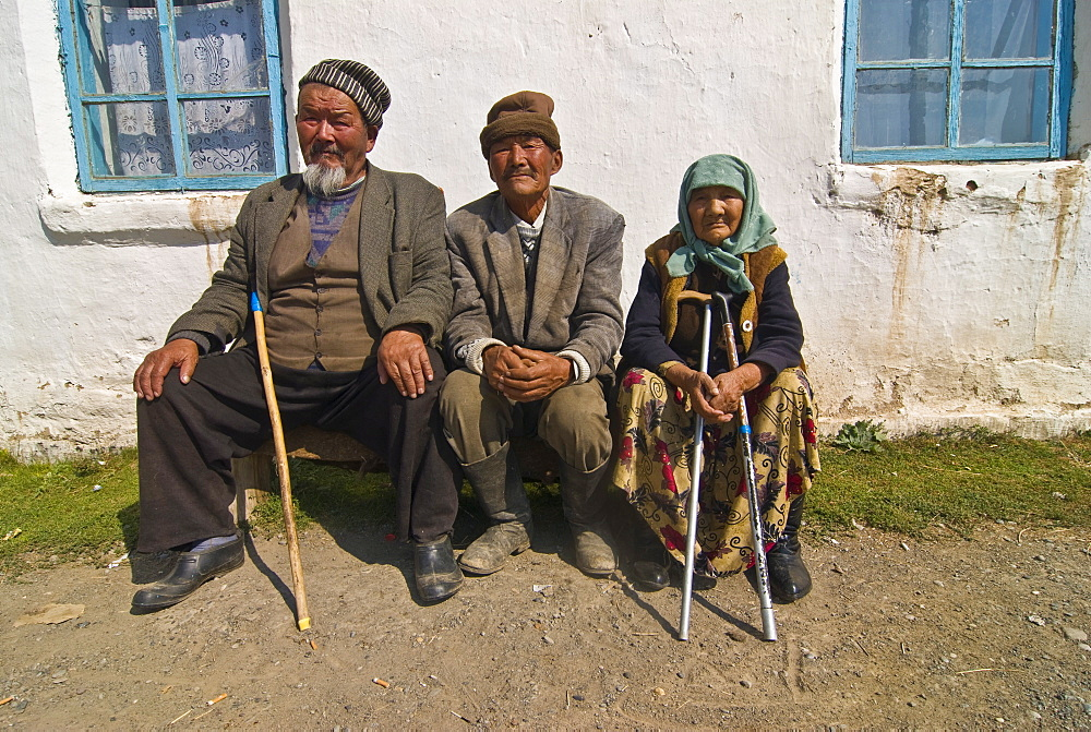 Three oldies sitting on a bench and having a chat, At Bashy, Kyrgyzstan, Central Asia, Asia