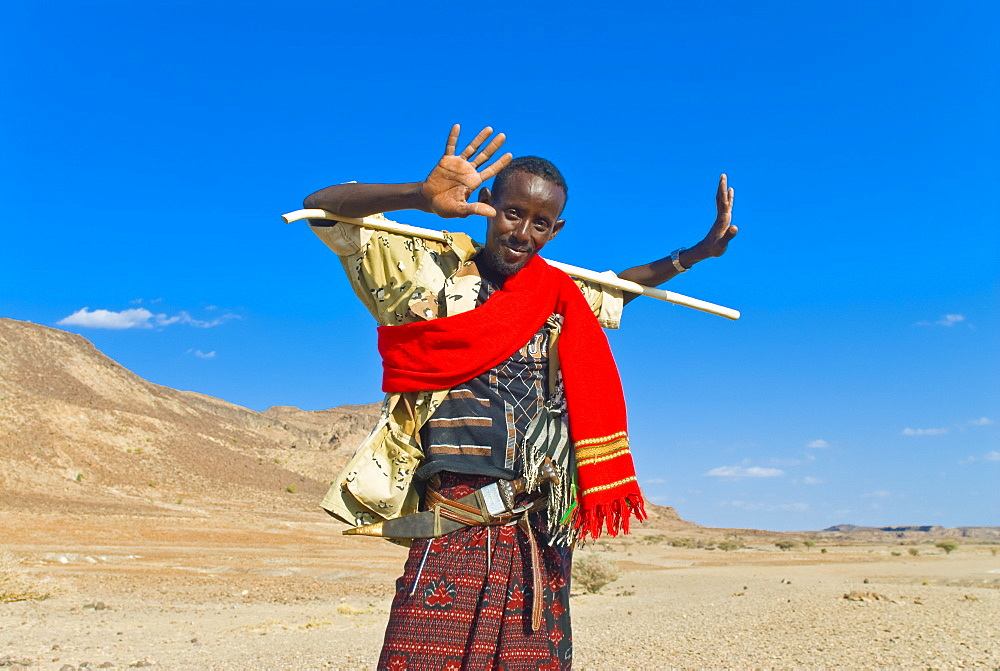 Afar tribesman on his way home, near Lac Abbe, Republic of Djibouti, Africa