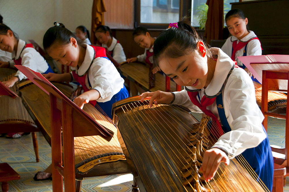 Young girls playing traditional instruments in the Schoolchildrens palace, Pyongyang, North Korea, Asia