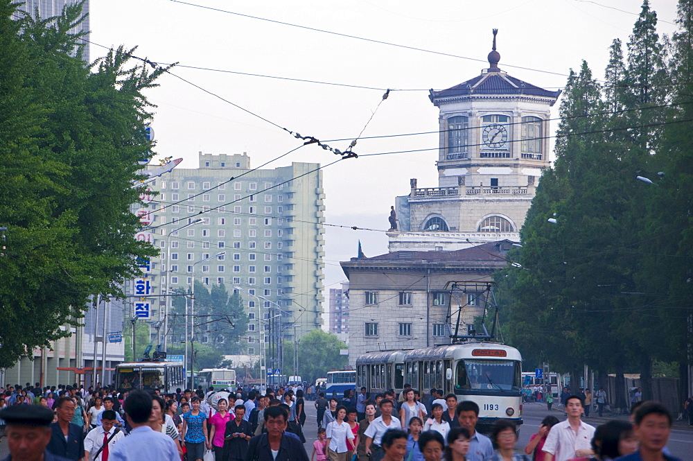 Busy street in front of the Pyongyang railway station, Pyongyang, North Korea, Asia