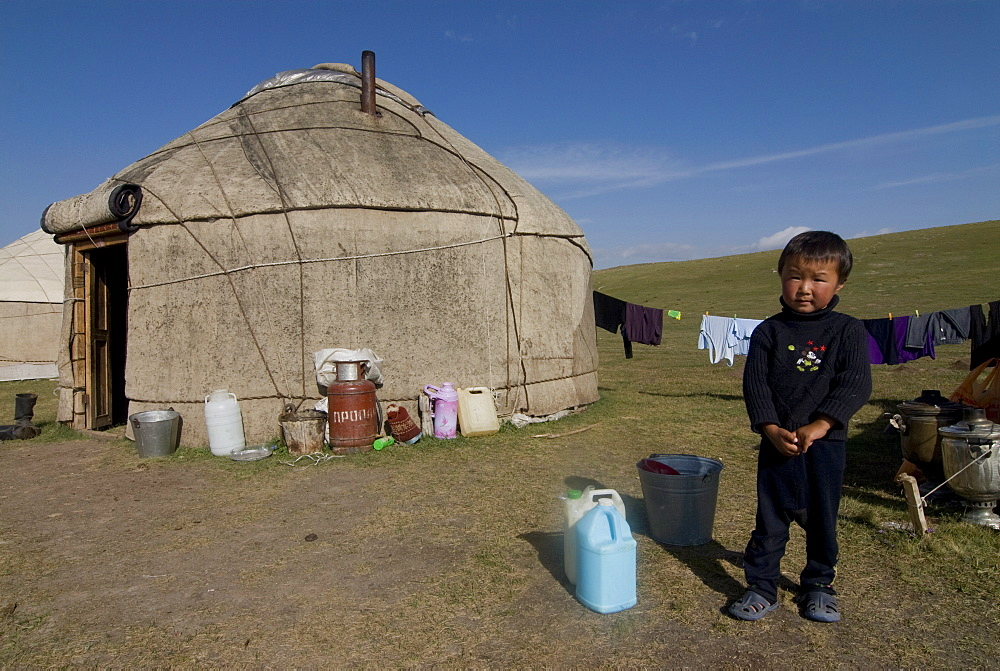 Kyrgyz boy in front of a yurt at Song Kol, Kyrgyzstan, Central Asia, Asia